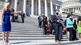 Greene heckles Democrats and they fire back on Capitol steps