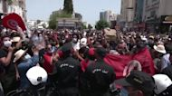 Tunisians protest as COVID surges and economy suffers