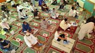 London's Muslim community observe social distancing while performing Eid al-Adha prayers