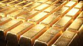 Gold climbs 1% as dollar, Treasury yields ease