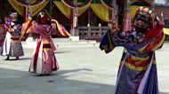 Bhutanese monks ward off evil spirits