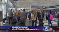 Travel restrictions still loom for some international travel