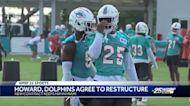 Howard, Dolphins agree to restructure