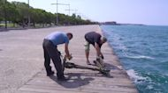 Divers retrieve dozens of electric scooters from sea near Thessaloniki, Greece