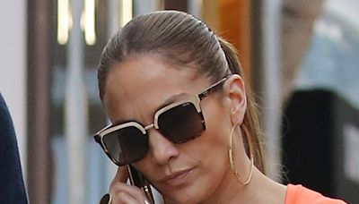 Jennifer Lopez Is a Tangerine Dream in a Neon Boilersuit & See-Through Sandals