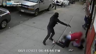 Shocking video shows gunman shooting at man in street with children between them