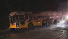 School bus carrying high school football players catches fire in Lexington.