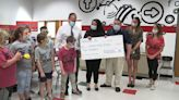 Auto dealerships thank Hickory schools with donation