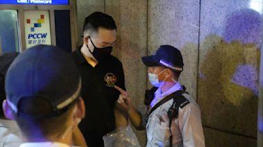 男子金鐘手舉黃黑旗 警方指違反國安法