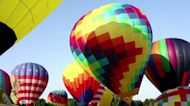 100 colorful balloons fill New Jersey sky