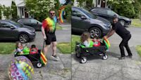 Dads celebrate Pride in their own mini-parade with young daughter and son
