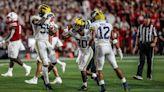 Dax Hill shares if he felt he got the INT vs. Nebraska, explains the taunting penalty