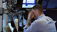 Dow tumbles more than 700 points amid COVID concerns