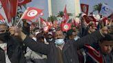 Tunisians protest amid political standoff