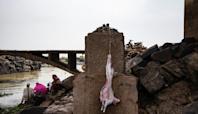 In Mali capital, animist sacrifices under 'Chinese bridge'