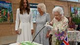 The Queen insisted on using a large ceremonial sword to cut a cake, prompting giggles from Kate Middleton