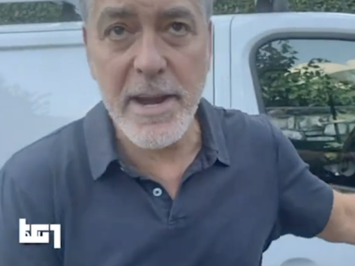 George Clooney seen helping locals in Italy after Lake Como is hit by flooding