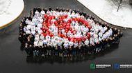 225 Engineering-Firm Employees Form Massive Kansas City Chiefs Arrowhead