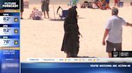 Protesting Grim Reaper makes bizarre TV news appearance
