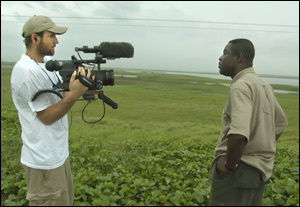 Isaac Brown, left, films Mike Anane in Accra, Ghana. Anane is a ...