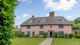 Pretty pink property with its own established vineyard for sale in Suffolk
