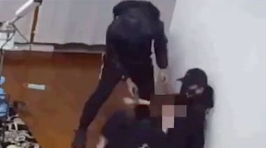 Security camera footage shows woman wrestling with gun-wielding robbers who burst into her home