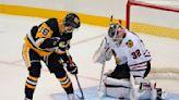 Penguins score 4 in 1st, beat Blackhawks 5-2 in home opener
