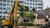 Final victim in condo collapse identified as death toll rises to 98