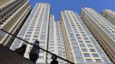 China Evergrande set to avert default as property developer reportedly pays off bond interest