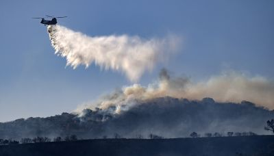 Fast-Moving Orange County Fires Explode As Santa Anas Howl; 2 Firefighters Gravely Injured – Updated