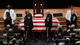 Colleagues grieve slain Alabama officer who has 3rd child on the way