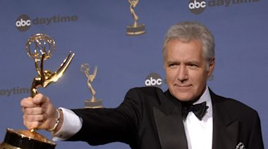 The late Alex Trebek hosted more than 8,200 'Jeopardy!' episodes, with his last slated to air on Christmas Day. Here's a look at his life and legacy, from his start as a Canadian sports announcer to Emmy-winning millionaire.