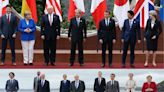 The 'family photo' of world leaders from Biden's first G7 summit is noticeably different from the one from Trump's first G7