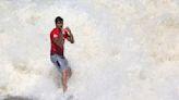 Surfing-Brazil's Medina overcomes Toledo, shark scare to win third world title