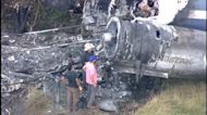 Federal investigators at site of MD-87 plane crash in Waller Co.