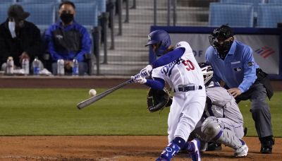 Betts, Bauer star for new fans as Dodgers crush Rockies 7-0