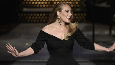 Adele says she still eats McDonald's once a week despite weight loss
