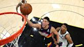 Suns' Booker will miss start of camp due to health protocols