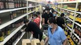 Panic-buyers raid Wuhan shop shelves as Covid cases in 'ground zero' surge