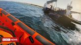 Two rescued from sailing boat pinned against Sandbanks chain ferry