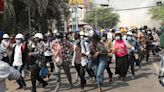 Myanmar crisis heightens with police raids and strike call