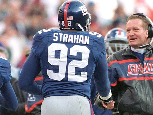 Michael Strahan Pays Tribute After Former NY Giants Coach Jim Fassel Dies at 71