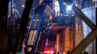 New York City bus left dangling from bridge after crash