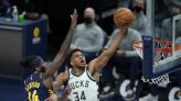 Antetokounmpo, Bucks roll past short-handed Pacers, 142-133