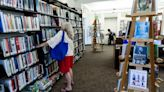 A library's late-books problem, school board meetings, a Northport show and more