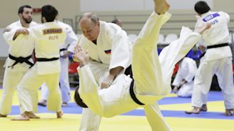 Putin injures finger during judo sparring but plays hockey with Belarus leader anyway