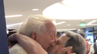 Man with Down syndrome, 53, showers dad in kisses at airport after week-long separation
