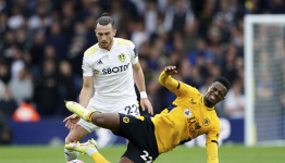 Late Rodrigo penalty earns Leeds 1-1 draw with Wolves in EPL