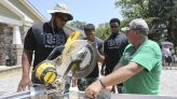 Alabama football players help build a family's dream home
