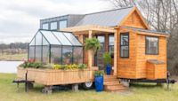 This tiny house looks incredible inside but the best part is the 'bonus' detachable greenhouse
